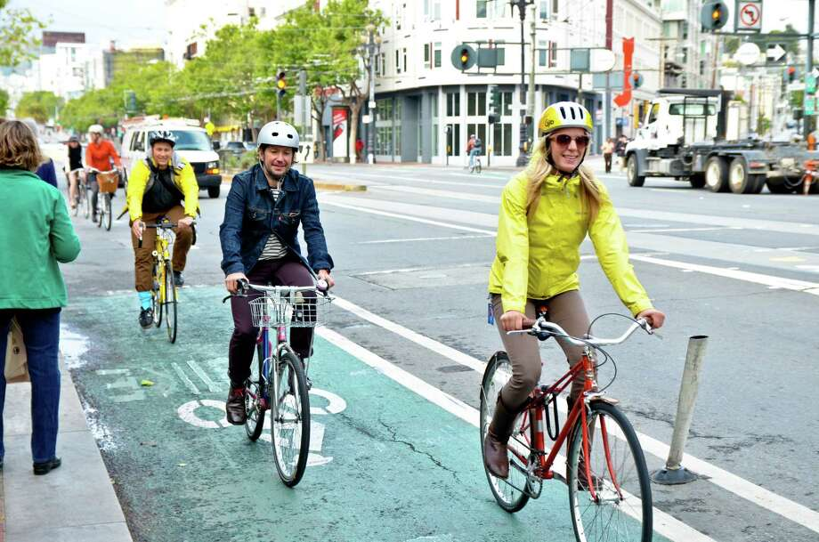 Bike to Work Day is set for May 14. Riders use a protected bike lane to get to work last May. Photo: Eric Tuvel / ONLINE_YES