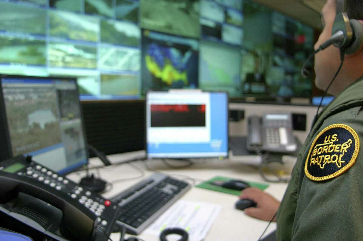 A U.S. Border Patrol agent monitors the network of cameras at the border patrol station in Laredo.