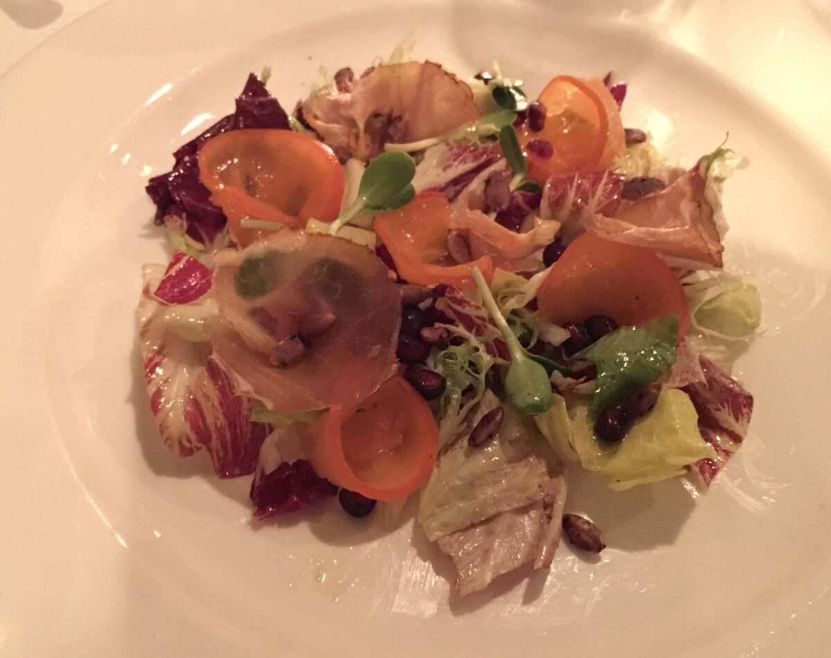 A mixed chicory and lomo salad is one of the choices for the first course on the fixed-price menu at Farmhouse Inn in Forestville.