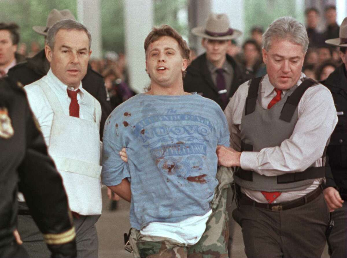 Ralph Tortorici is led away by police after he held 35 students hostage for 2 hours at the University at Albany iin December 1994. He fired a weapon at State Police hostage negotiators before wounding one of the hostages, student Jason McEnaney, who knocked the gun out of his hands. (Tim Roske/Associated Press/archive)