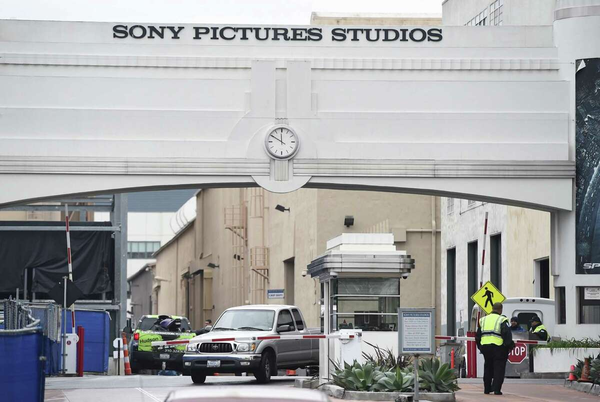 """Tuesday's threat of terrorism poses an ugly dilemma for Sony and exhibitors: whether to pull """"The Interview,"""" caving to hackers who have wreaked havoc with Sony's digital systems for weeks in an attempt to block the release, or to forge ahead, risking possible violence and potential legal liability."""