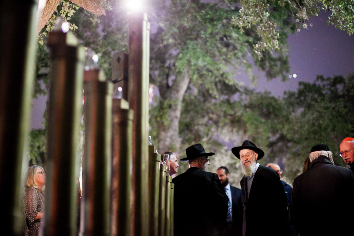 Members of the Jewish community meet Tuesday Dec. 16, 2014 in front of Shavano Park's city hall during the lighting Hanukkah ceremony. This is the first celebration of it's kind, and the menorah will be lit every night until the final night on Wednesday Dec. 24.