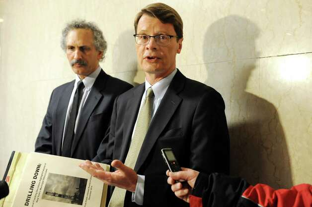 Blair Horner, right, and Russ Haven of NYPIRG release a report that examines 59 local governments decisions to support hydraulic fracturing on Tuesday Dec. 16, 2014, at the Capitol in Albany, N.Y. (Cindy Schultz / Times Union) Photo: Cindy Schultz / 00029874A