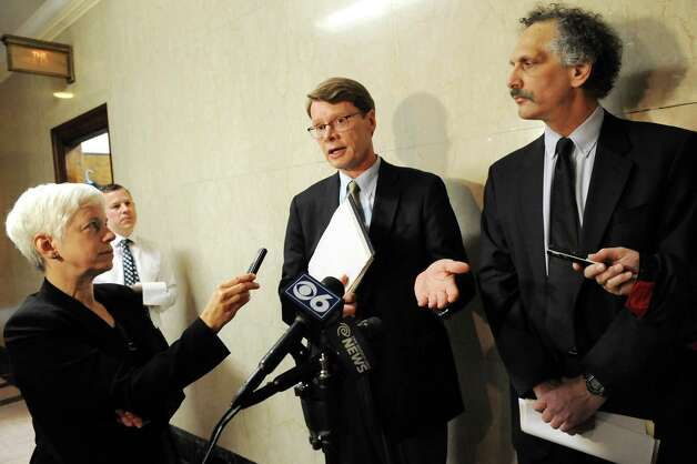 Blair Horner, center, and Russ Haven, right, of NYPIRG release a report that examines 59 local governments decisions to support hydraulic fracturing on Tuesday Dec. 16, 2014, at the Capitol in Albany, N.Y. (Cindy Schultz / Times Union) Photo: Cindy Schultz / 00029874A