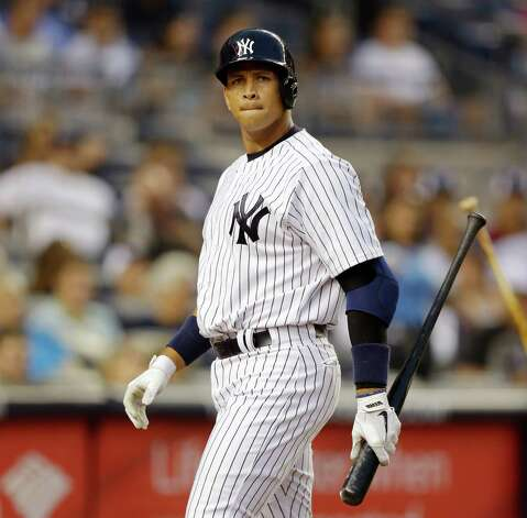 "FILE - In this Aug. 20, 2013, file photo, New York Yankees Alex Rodriguez reacts after striking out in the second inning of the second game of a baseball doubleheader at Yankee Stadium in New York. Yankees general manager Brian Cashman says Alex Rodriguez's days as an everyday fielder are over and he hopes A-Rod will be New York's fulltime designated hitter.  Cashman said during a telephone interview with The Associated Press on Tuesday, Dec. 16, 2014,  that ""I can't expect Alex to be anything."" (AP Photo/Kathy Willens, File) ORG XMIT: NY175 Photo: Kathy Willens / AP"