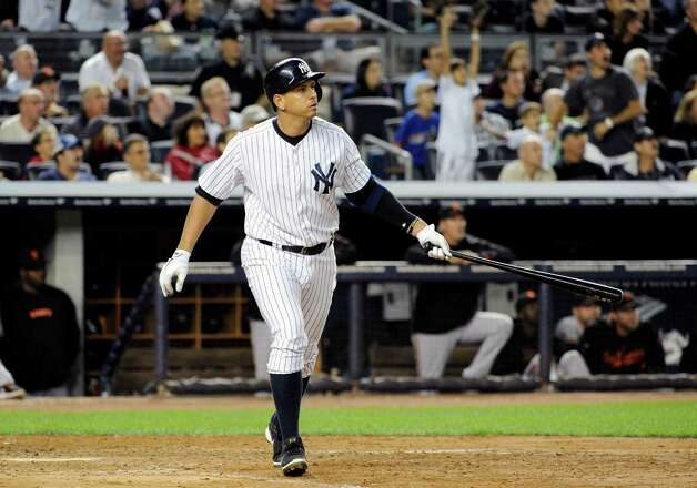 "FILE - In this Sept. 20, 2013, file photo, New York Yankees' Alex Rodriguez watches his grand slam home run during the seventh inning of an interleague baseball game against the San Francisco Giants at Yankee Stadium in New York. Yankees general manager Brian Cashman says Rodriguez's days as an everyday fielder are over and he hopes A-Rod will be New York's fulltime designated hitter.  Cashman said during a telephone interview with The Associated Press on Tuesday, Dec. 16, 2014,  that ""I can't expect Alex to be anything.""(AP Photo/Bill Kostroun, File) ORG XMIT: NY174 Photo: Bill Kostroun / FR51951 AP"