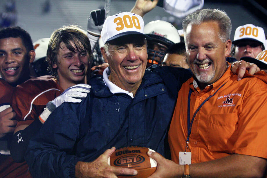 Madison coach Jim Streety gets the game ball after his team beat New Braunfels 21-13 to give him his 300th high school win in 2009. Photo: Tom Reel /San Antonio Express-News / treel@express-news.net