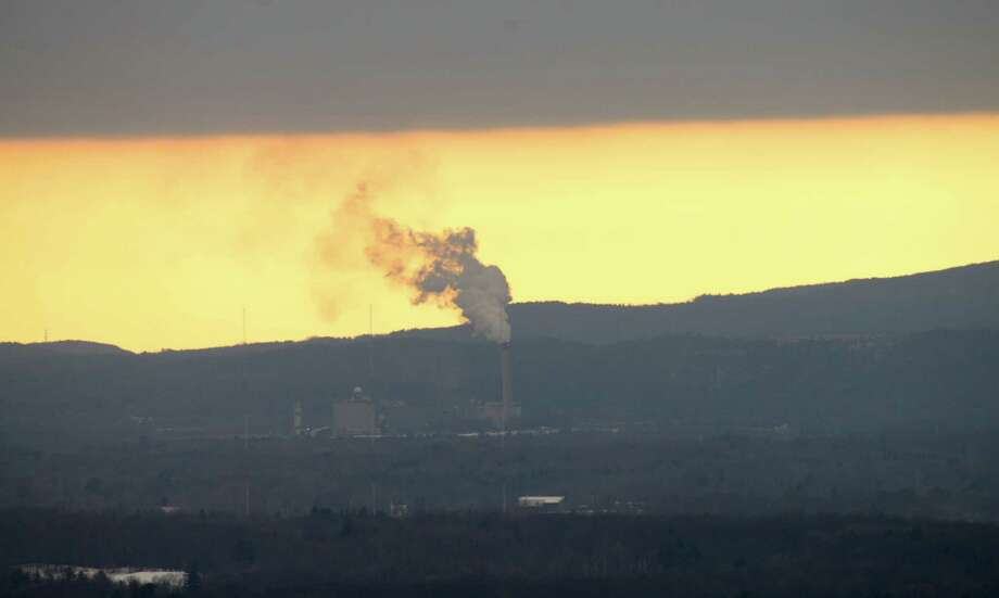 Emissions rise from the LaFarge cement plant in Ravena Monday afternoon, Dec. 15, 2014, viewed from Corning Tower in Albany, N.Y. (Will Waldron/Times Union) Photo: WW