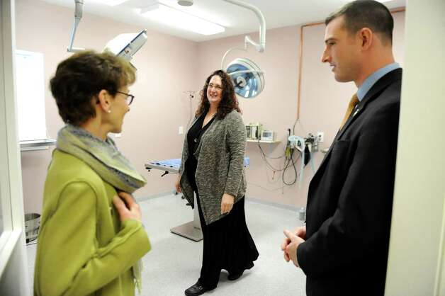 Veterinarian Kimberly Linendoll, center, shows city council members Lynn Kopka, left, and Jim Gordon one of the surgery rooms on Tuesday Dec. 16, 2014, at the Collar City Animal Hospital in Troy, N.Y. (Cindy Schultz / Times Union) Photo: Cindy Schultz / 00029872A