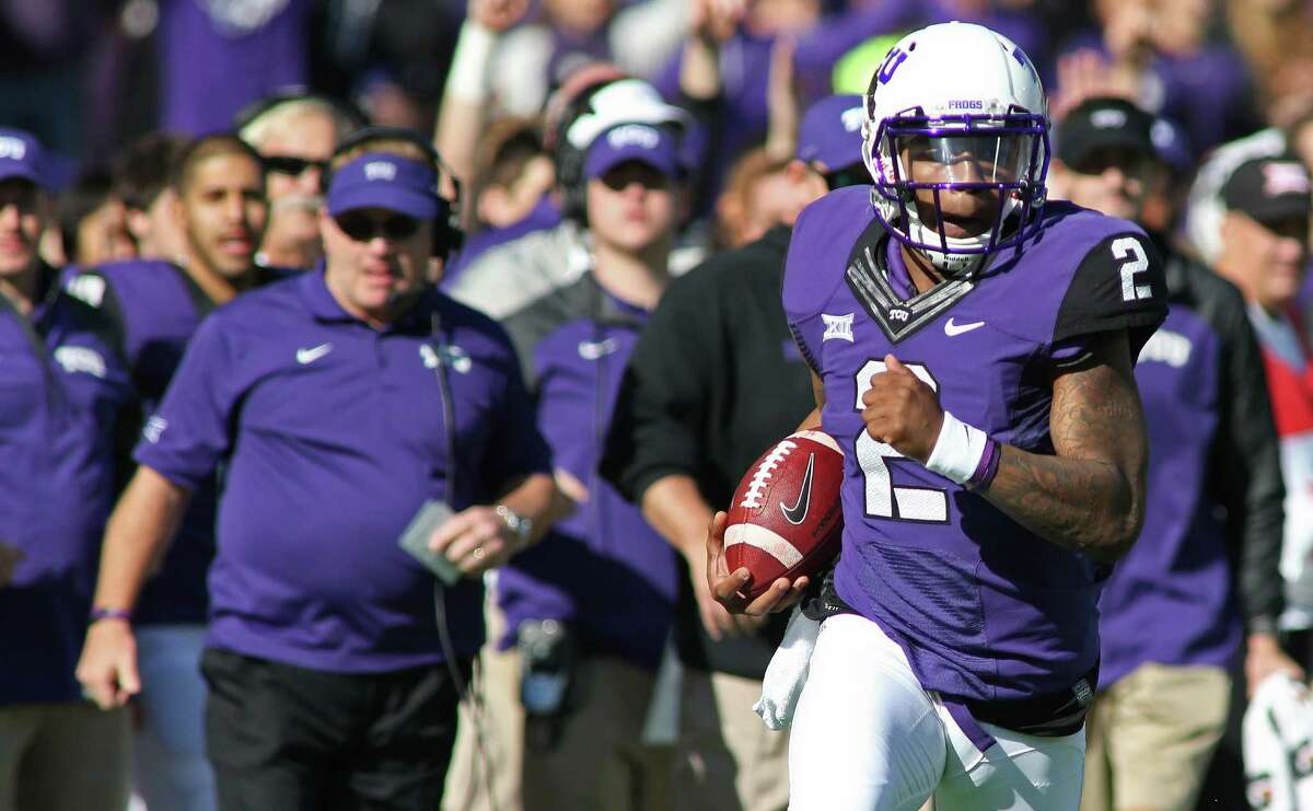 TCU quarterback Trevone Boykin scores a touchdown during the first half of against Iowa State at Amon G. Carter Stadium on Dec. 6, 2014, in Fort Worth.
