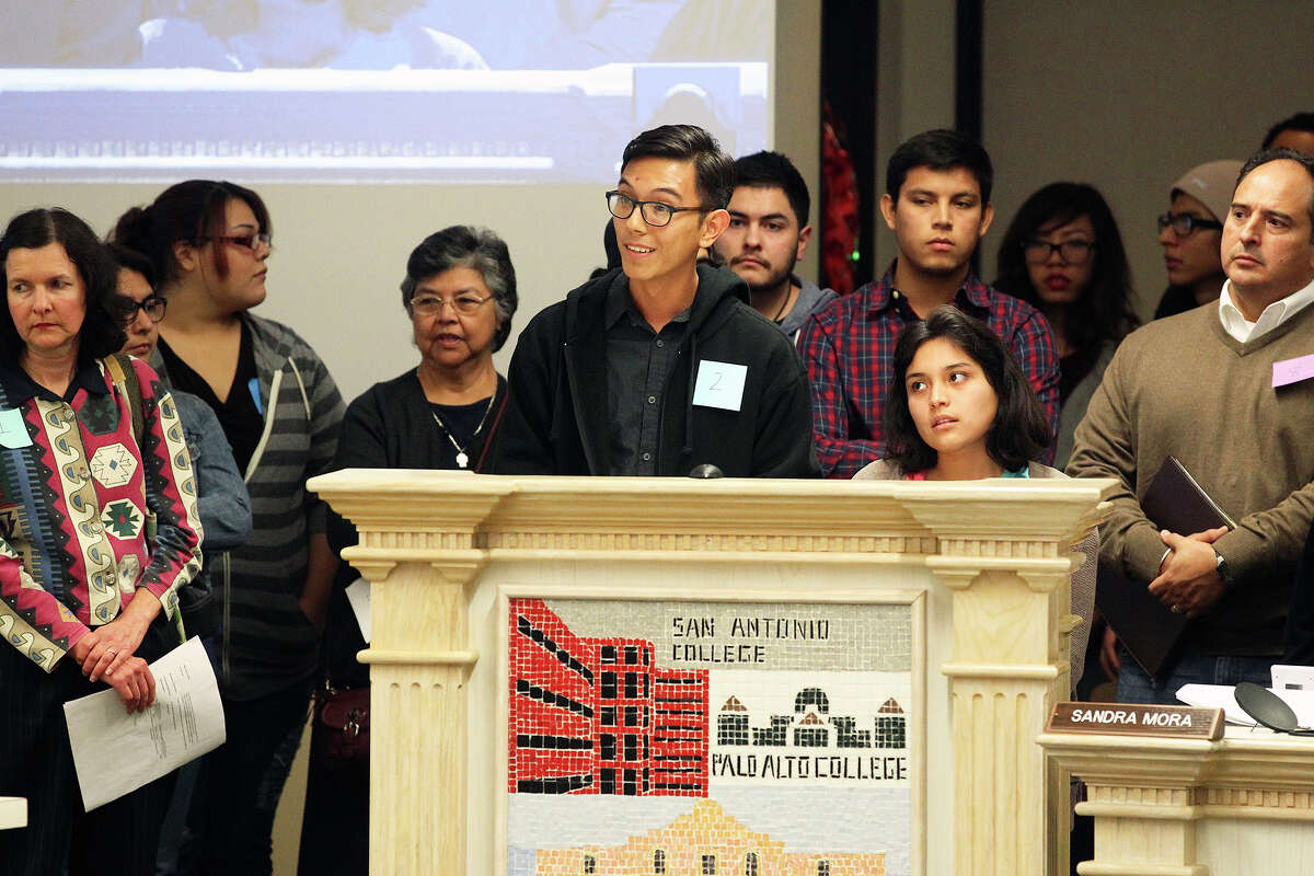 Simon Sanchez and Madelyn Martinez, speaking for the Student Leadership Coalition of Alamo Colleges, direct comments concerning the listing of majors on diplomas to the Alamo Community Colleges board of trustees during their meeting on December 116, 2014.