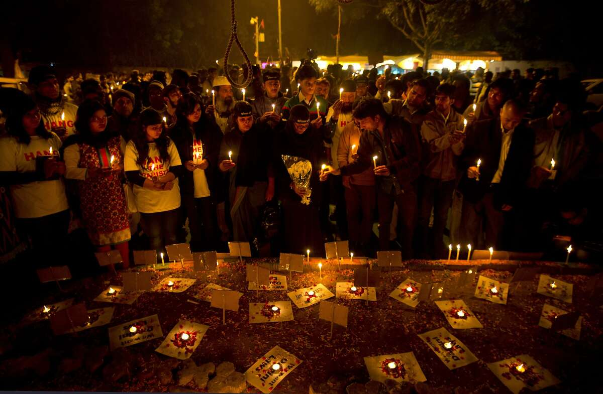 A noose hangs demanding death penalty for rapists, as Indians participate in a candlelit vigil protesting violence against women as they mark the second anniversary of the deadly gang rape of a student on a bus, in New Delhi, India, Tuesday, Dec. 16, 2014. The case sparked public outrage and helped make women's safety a common topic of conversation in a country where rape is often viewed as a woman's personal shame to bear. (AP Photo/Saurabh Das)