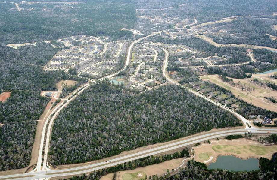 2013: Aerial photo of Woodforest, a 3,000-acre community between The Woodlands and Conroe. / handout
