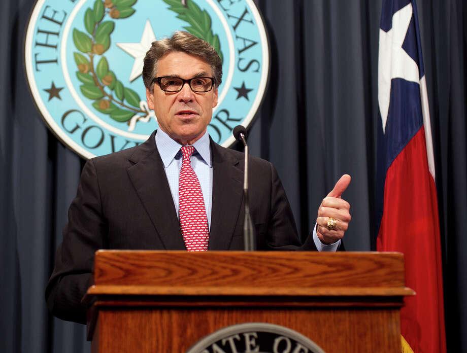 Rick Perry presided over not one, but two venture capital programs. (AP Photo/Austin American-Statesman, Deborah Cannon) Photo: Deborah Cannon, MBO / Austin American-Statesman