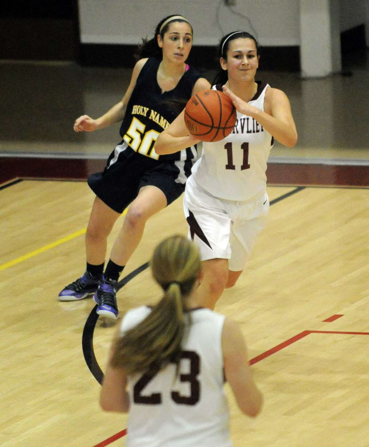 Watervliet's Meghan Capone looks to pass during their high school girl's basketball game against Holy Names on Tuesday Dec. 16, 2014 in Watervliet ,N.Y. (Michael P. Farrell/Times Union)