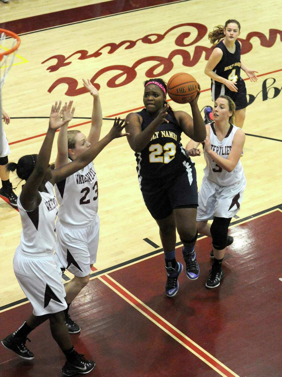 Holy Names Deja Deas drives to the hoop during their high school girl's basketball game against Watervliet on Tuesday Dec. 16, 2014 in Watervliet ,N.Y. (Michael P. Farrell/Times Union)