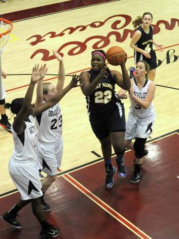 Holy Names Deja Deas drives to the hoop during their high school girl's basketball game against Watervliet on Tuesday Dec. 16, 2014 in Watervliet ,N.Y. (Michael P. Farrell/Times Union) Photo: Michael P. Farrell / 00029858A