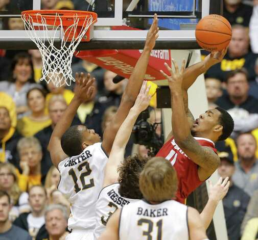 Wichita State's Darius Carter, left, Evan Wessel (3) and Ron Baker (31) try to block the shot of Alabama's Shannon Hale during the first half of the NCAA college basketball game in Wichita, Kan., on Tuesday, Dec. 16, 2014. (AP Photo/The Wichita Eagle, Travis Heying) ORG XMIT: KSWIE105 Photo: Travis Heying / The Wichita Eagle