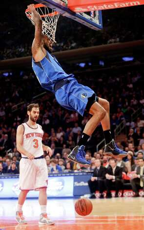 Dallas Mavericks' Tyson Chandler, top, dunks the ball in front of New York Knicks' Jose Calderon (3) during the first half of an NBA basketball game Tuesday, Dec. 16, 2014, in New York.  (AP Photo/Frank Franklin II) ORG XMIT: MSG103 Photo: Frank Franklin II / AP