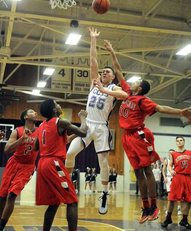 CCHS's Anthony Mack goes in for a score during their high school boy's basketball game against Schenectady on Tuesday Dec. 16, 2014 in Troy ,N.Y. (Michael P. Farrell/Times Union) Photo: Michael P. Farrell / 00029857A