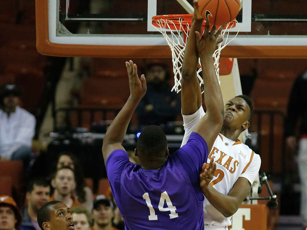 AUSTIN, TX - DECEMBER 16: Myles Turner #52 of the Texas Longhorns blocks a shot by Chad Lang #14 of the Lipscomb Bisons at the Frank Erwin Center on December 16, 2014 in Austin, Texas. (Photo by Chris Covatta/Getty Images)
