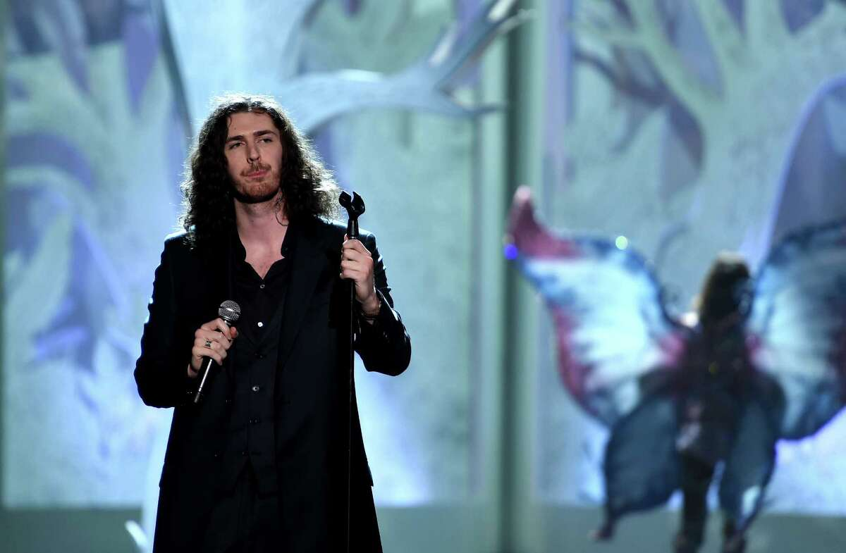 Hozier performs on the runway during the 2014 Victoria's Secret Fashion Show at Earl's Court Exhibition Centre on Dec. 2, 2014 in London, England.