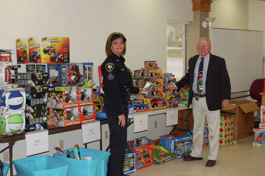 Wanda Brister and Robert MacDonald with toys for the Jasper PD Toys for Tots program. photo by Jeff Reedy