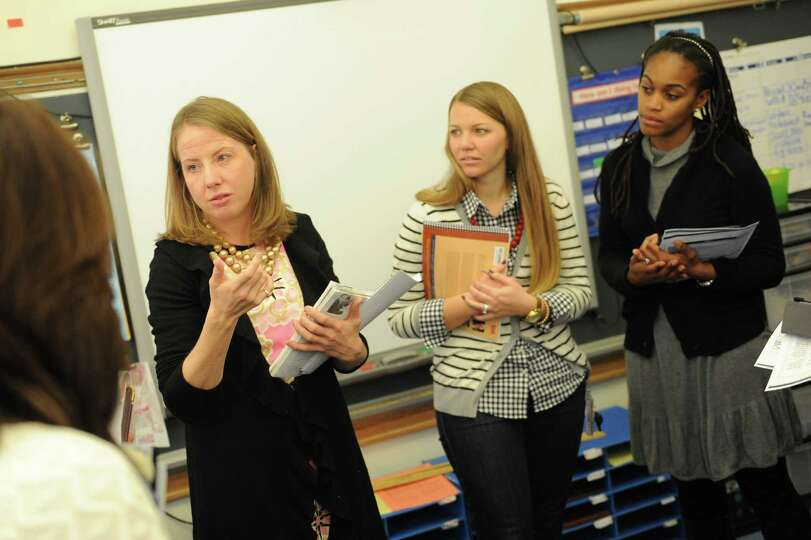 Meghan Hargrave, left, a Staff Developer with Columbia University Teachers College, talks about teac