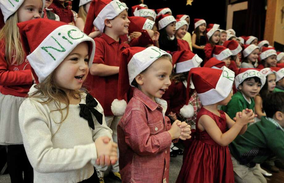 Nicole Petrillo, left, and Jaden Scott, right, sing during a performance in the Saint Joseph School annual pre-k Christmas concert on Wednesday, December 17, 2014, in Danbury, Conn. Photo: H John Voorhees III / The News-Times