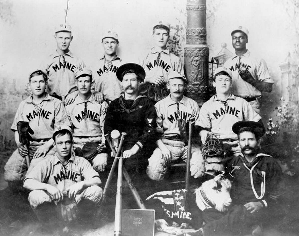 An 1898 group shot of the U.S.S. Maine baseball team which won the previous year's Navy baseball championship. All but one member of the team subsequently perished when the Maine exploded in Havana harbor. African American pitcher William Lambert, back row, far right, was their star player.