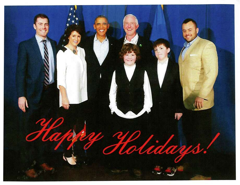 The holiday card Mayor Bill Finch is mailing around features a photo of the mayor and his family posing with President Obama taken when the president was in the city on a campaign stump for Gov. Dannel Malloy. Photo: Contributed Photo / Connecticut Post Contributed