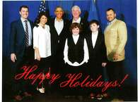 The holiday card Mayor Bill Finch is mailing around features a photo of the mayor and his family posing with President Obama taken when the president was in the city on a campaign stump for Gov. Dannel Malloy.
