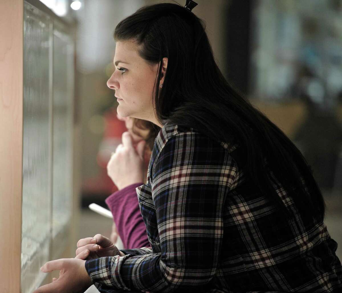 Heather Fox, of Carmel, New York, bends down to look in a display case at the Danbury Fair Mall, on Wednesday, December 17, 2014.