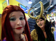 Delaney Howe, of Woodbury, and her friend Summer Kucky, of Newtown, at right, dress up as their favorite characters during Connecticut ComiCONN at the Webster Bank Arena in downtown Bridgeport, Conn. on Friday, August 15, 2014. The Connecticut ComiCONN is leaving Bridgeport next August and going to the Mohegan Sun in Ledyard.