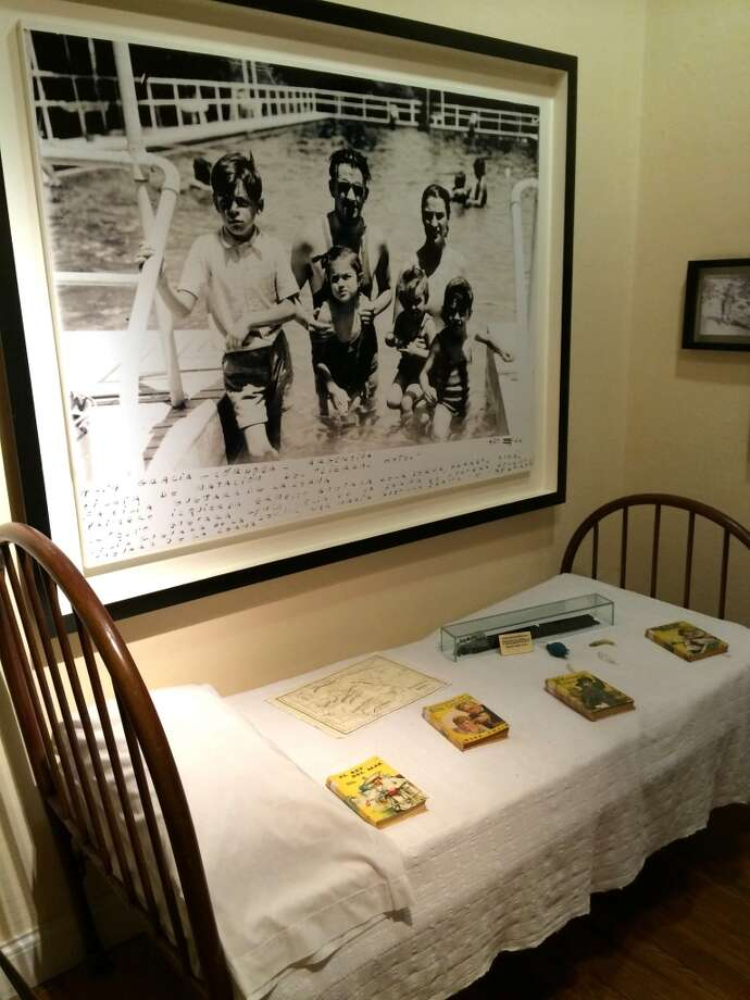 """Che the Youngster: While it's difficult to picture him without the trademark beard, at some point this revolutionary leader was """"little Ernesto."""" At the museum-home, Che's room is set up with early family photos and his bed. Photo: Spud Hilton, Bad Latitude"""