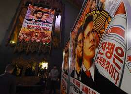 "Movie posters for the premiere of the film ""The Interview"" at The Theatre at Ace Hotel in Los Angeles, California on December 11, 2014.   The film, starring US actors Seth Rogen and James Franco, is a  comedy about a CIA plot to assassinate its leader Kim Jong-Un, played by Randall Park.  North Korea has vowed ""merciless retaliation"" against what it calls a ""wanton act of terror"" -- although it has denied involvement in a massive cyber attack on Sony Pictures, the studio behind the film.                    AFP PHOTO/STR-/AFP/Getty Images"