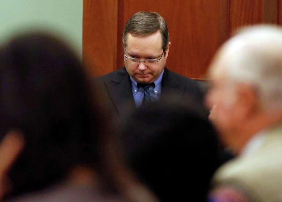 Eric Williams walks in the courtroom to hear his sentence during his capital murder trial in 2014 in Rockwall, Texas. Photo: Vernon Bryant, Associated Press / Pool The Dallas Morning News