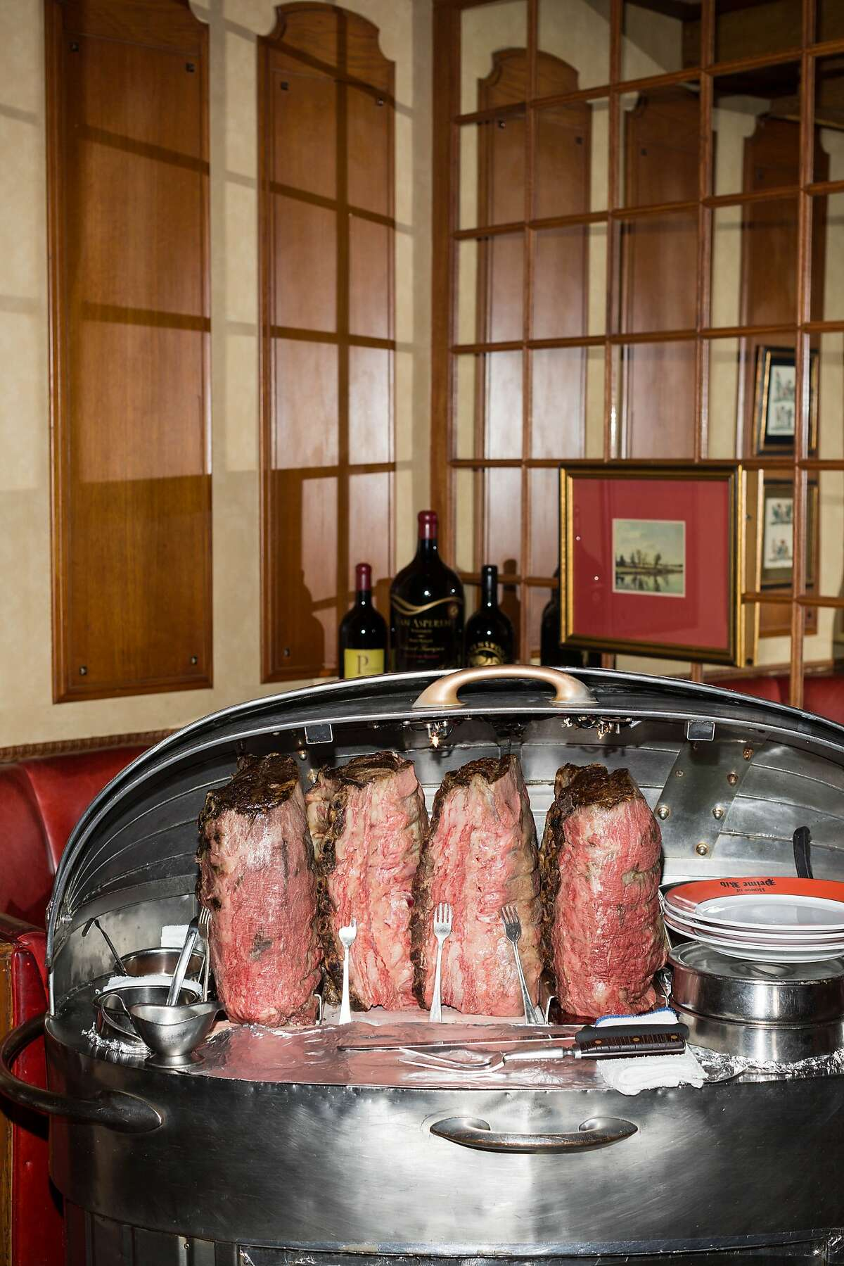 Prime Rib is served on metal carts wheeled through the restaurant and sliced table side at House of Prime Rib in San Francisco, Calif., Monday, November 17, 2014.