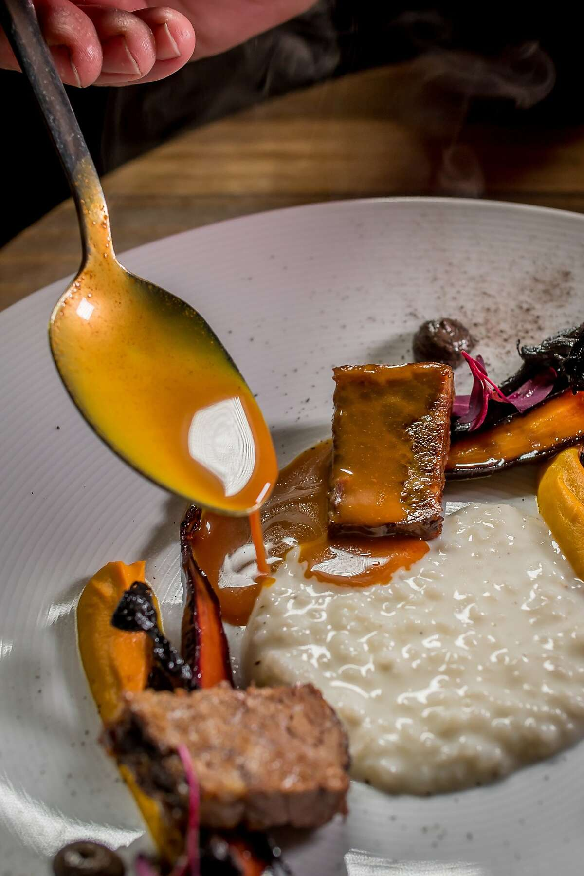 The Beef Short Rib course being sauced at Lazy Bear in San Francisco, Calif. on December 13th, 2014.