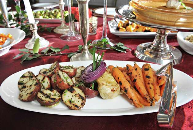 Grilled new potatoes and baby carrots on a holiday table at Mazzone Hospitality Corporate Headquarters Wednesday Nov. 12, 2014, in Clifton Park, NY.  (John Carl D'Annibale / Times Union) Photo: John Carl D'Annibale / 00029449A
