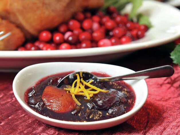 Cranberry sauce with strips of orange zest on a holiday table at Mazzone Hospitality Corporate Headquarters Wednesday Nov. 12, 2014, in Clifton Park, NY.  (John Carl D'Annibale / Times Union) Photo: John Carl D'Annibale / 00029449A