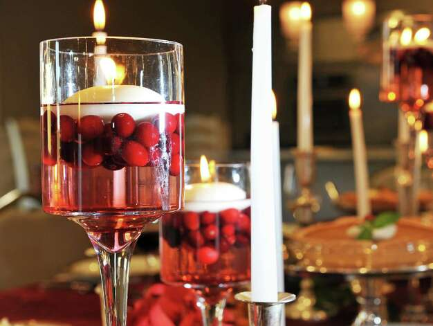 Floating candles with cranberries on a holiday table at Mazzone Hospitality Corporate Headquarters Wednesday Nov. 12, 2014, in Clifton Park, NY.  (John Carl D'Annibale / Times Union) Photo: John Carl D'Annibale / 00029449A
