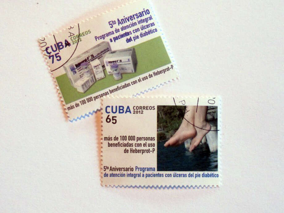Cuban stamps issued in 2012 commemorating the fifth anniversary of Heberprot and the 100,000 patients worldwide that had been treated with the anti-amputation medication.   The number is now estimated at at more than 170,000. Photo: Contributed Photo, Andrew Schneider / Connecticut Post Contributed