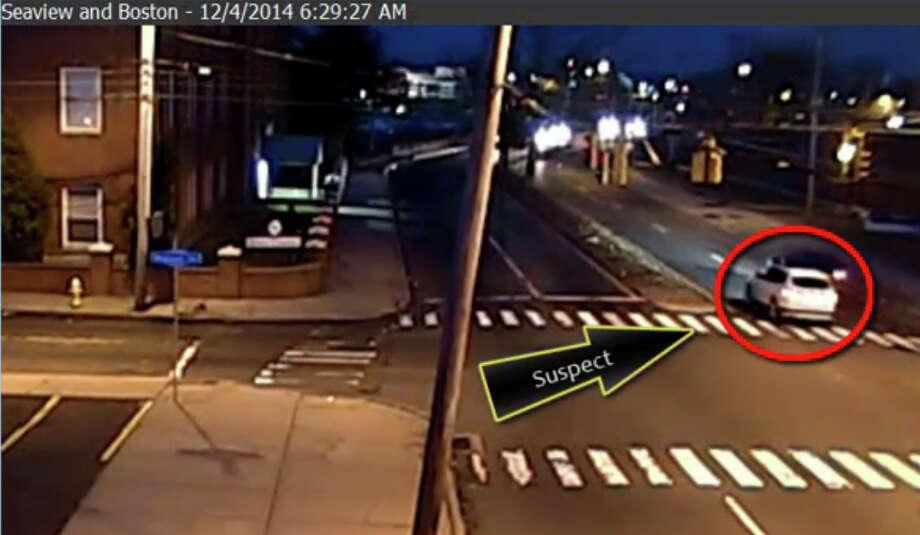 An image from surveillance video shows the Subaru driven by Evelyn Agyei struck from behind several times by a white BMW X-3 on Boston Avenue on the morning of December 4, 2014.  A corrections officer has been questioned in connection with the Dec. 4 hit-and-run crash that killed Agyei and injured her son on Boston Avenue, according to police and corrections sources. Photo: Contributed Photo / Connecticut Post Contributed