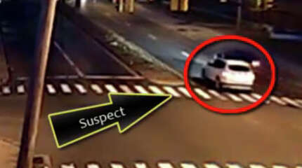 An image from surveillance video shows the Subaru driven by Evelyn Agyei struck from behind several times by a white BMW X-3 on Boston Avenue on the morning of December 4, 2014.  A corrections officer has been questioned in connection with the Dec. 4 hit-and-run crash that killed Agyei and injured her son on Boston Avenue, according to police and corrections sources.