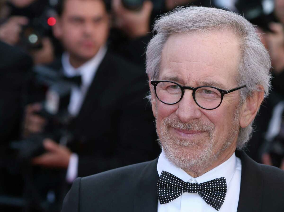 """In this May 25, 2013 file photo, jury president, director Steven Spielberg, arrives for the screening of the film Venus in Fur at the 66th international film festival, in Cannes, southern France. Spielberg?'s next two films have been slated for October 2015 and July 2016. DreamWorks announced Monday, June 16, 2014, that an untitled Cold War spy thriller from Spielberg will open October 16 next year, and ?""""The BFG?"""" is planned for July 1, 2016. (Photo by Joel Ryan/Invision/AP, file) ORG XMIT: CAET952"""