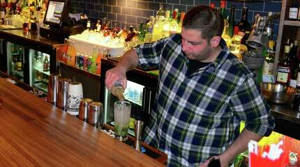 Jeremy Marshall, a bartender at Bodega Taco Bar on Post Road in Fairfield, Conn., makes a mojito at the restaurant in Fairfield, Conn., on Wednesday Dec. 17, 2014. President Obama announced a thawing in US relations with Cuba after the release of an American prisoner there.