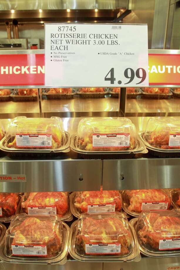 Rotisserie chicken in the deli department. One of Costco's signature items. Photo: Gary Fountain, Freelance / Copyright 2013 Gary Fountain