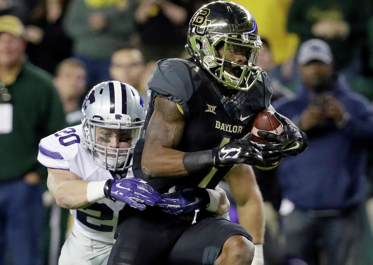 Baylor's Corey Coleman fights for extra yardage as Kansas State's Dylan Schellenberg makes the tackle during the first half on Dec. 6, 2014, in Waco.