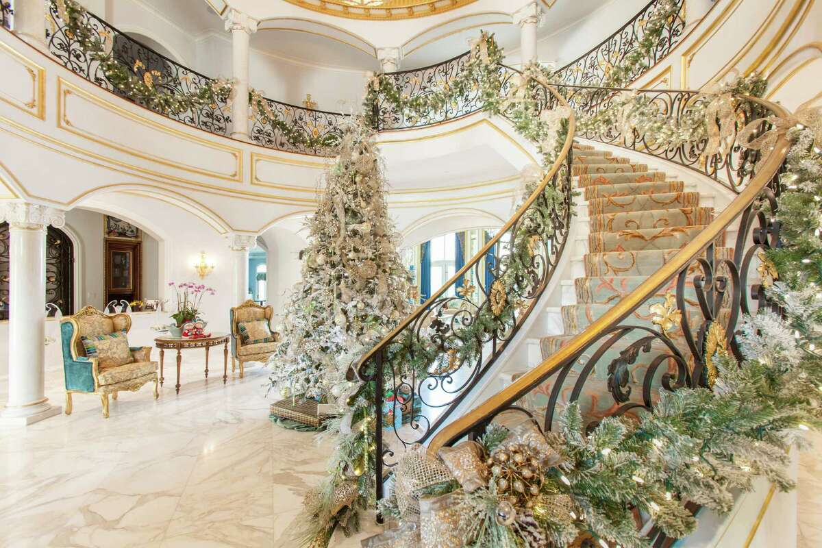 These River Oaks homeowners didn't want traditional red holiday decor, so Gust used a blend of creams, pale greens and white with a bit of pink and blush.